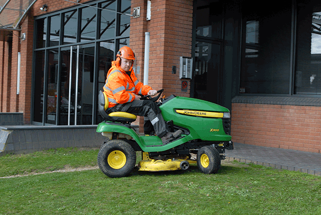 commercial_grass_mower_outside_office_building